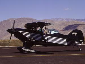 Bi-Plane on Runway by Larry McManus