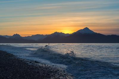 Surfer in Waves at Sunrise by Latitude 59 LLP