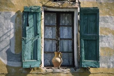 Typical French Window, with Turquoise Wooden Shutters and Terracotta Jug