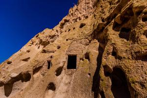 Cave dwellings on the Cliffside of Pueblo Indian Ruins in Bandelier National Monument, USA by Laura Grier