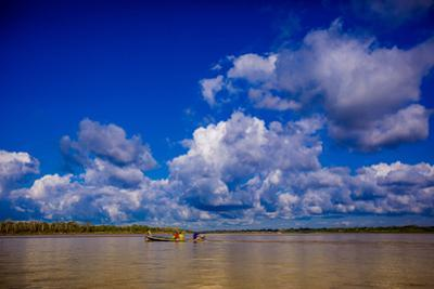 Family on a Canoe, Amazon River, Iquitos, Peru, South America by Laura Grier