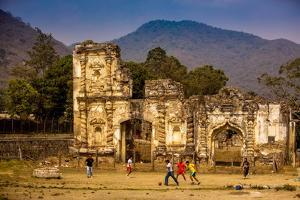 Kids Playing Soccer at Ruins in Antigua, Guatemala, Central America by Laura Grier