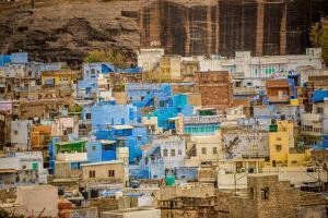 Mehrangarh Fort Towering over the Blue Rooftops in Jodhpur, the Blue City, Rajasthan, India, Asia by Laura Grier