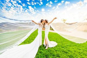 Newlyweds first look post wedding ceremony, Corona, California, USA by Laura Grier
