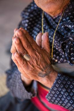 Old woman's hands praying, Bhaktapur, Nepal, Asia by Laura Grier