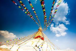 Prayer flags and Buddhist stupa at Bouddha (Boudhanath), UNESCO World Heritage Site, Kathmandu, Nep by Laura Grier