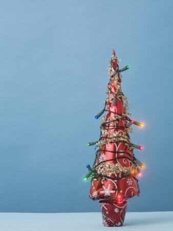 Christmas Tree with Lights and Blue Background