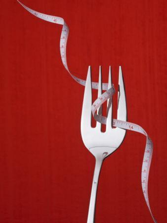 Fork with Measuring Tape Wrapped around It