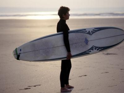 Surfer on a Beach, North Devon, England by Lauree Feldman