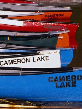 Canoes at Cameron Lake, Waterton Lakes National Park, Alberta, Canada by Lawrence Worcester
