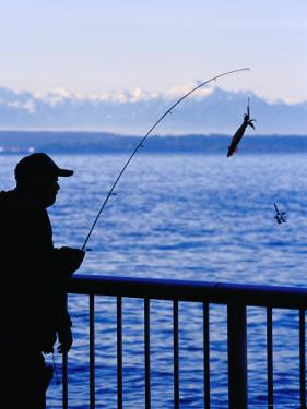 Fisherman on Waterfront Park, Seattle, Washington, USA by Lawrence Worcester