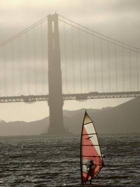 Windsurfer Sails Through Waters on San Francisco Bay, San Francisco, California, USA by Lawrence Worcester