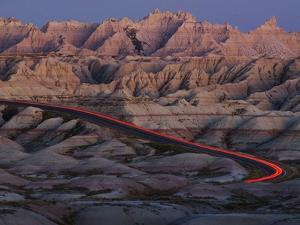 Car Traveling Through Badlands National Park by Layne Kennedy