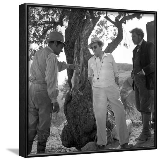 LE GUEPARD, 1963 by Luchino Visconti ici sur le tournage with Serge Reggiani and Burt Lancaster (b/--Framed Photo