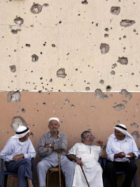 Lebanese Residents Rest in Front of a Wall