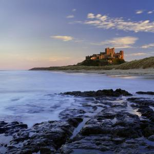 Bamburgh Castle Bathed in Warm Evening Light, Bamburgh, Northumberland, England, United Kingdom by Lee Frost