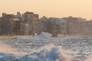 Buildings Along the Malecon in Soft Evening Sunlight with Large Waves Crashing Against the Sea Wall by Lee Frost