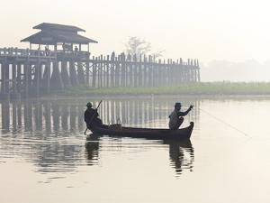 Fisherman on Taungthaman Lake in Mist at Dawn with U Bein Bridge by Lee Frost