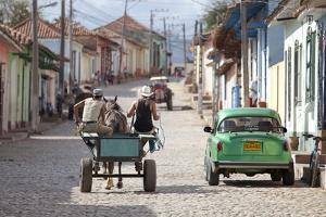 Horse and Cart and Vintage American Car on Cobbled Street in the Historic Centre of Trinidad by Lee Frost