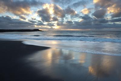 Looking Towards the North Atlantic at Sunrise from the Black Volcanic Sand Beach at Vik I Myrdal