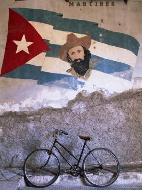 Mural of Camilo Cienfuergos on Wall Above a Bicycle, Havana, Cuba, West Indies, Central America by Lee Frost