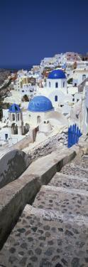 Oia with Blue-Domed Churches and Whitewashed Buildings, Santorini, Cyclades, Greek Islands, Greece by Lee Frost
