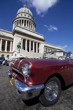 Red Vintage American Car Parked Opposite the Capitolio by Lee Frost