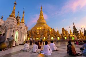 Shwedagon Paya (Pagoda) at Dusk with Buddhist Worshippers Praying by Lee Frost