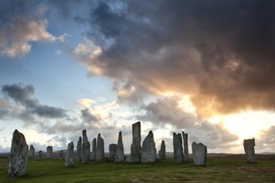 Standing Stones of Callanish at Sunset with Dramatic Sky in the Background by Lee Frost