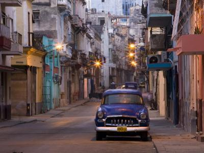 View Along Quiet Street at Dawn Showing Old American Car and Street Lights Still On, Havana, Cuba by Lee Frost