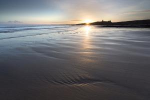 View over Embleton Beach at Sunrise Towards the Silhouetted Ruin of Dunstanburgh Castle by Lee Frost