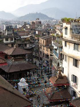 View over Narrow Streets and Rooftops Near Durbar Square Towards the Hilltop Temple of Swayambhunat by Lee Frost
