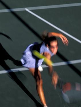 Woman Playing Tennis, Colorado, USA by Lee Kopfler