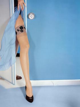 Leg of Model Showing 10-Denier Sandlefoot Stocking