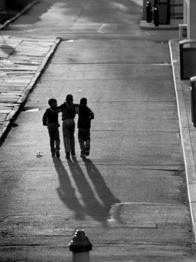 Three Boys Walking Down Street Arm in Arm by Len Rubenstein