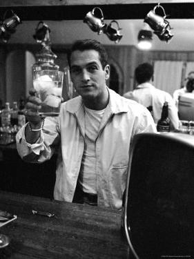 Actor Paul Newman Raising a Glass During an Informal Party by Leonard Mccombe