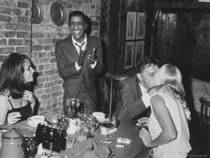 Actors Sammy Davis Jr. and Richard Burton and May Britt by Leonard Mccombe