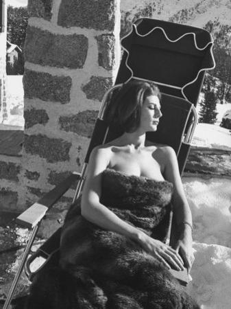 Baroness Fiona Thyssen-Bornemisza Sun-Bathing Wrapped in a Fur Rug at Resort