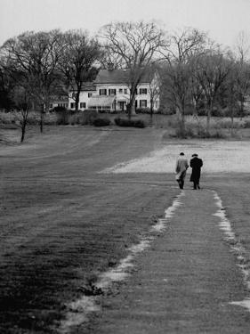 Distant of Mathematicians Albert Einstein and Kurt Godel Taking a Walk by Leonard Mccombe
