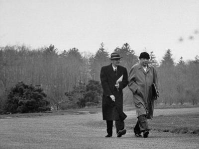 Mathematicians Albert Einstein and Kurt Godel Taking a Walk