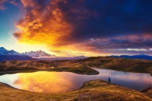 Fantastic Lake Koruldi with Overcast Sky at the Foot of Mt. Ushba. Dramatic Morning Scene. Upper Sv by Leonid Tit