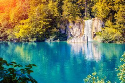 Majestic View on Waterfall with Turquoise Water and Sunny Beams in Plitvice Lakes National Park. Fo by Leonid Tit