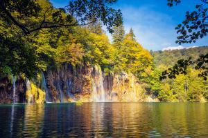 Majestic View on Waterfall with Turquoise Water and Sunny Beams in the Plitvice Lakes National Park by Leonid Tit