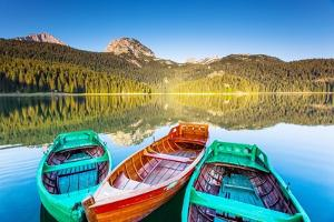 Reflection In Water Of Mountain Lakes And Boats by Leonid Tit