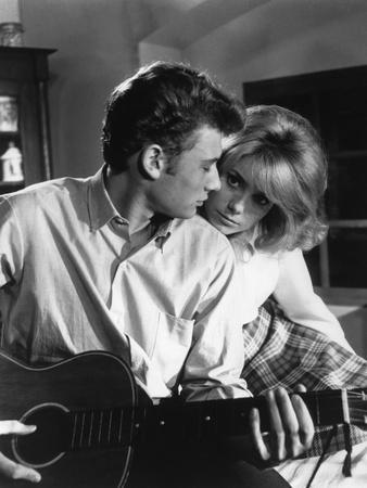https://imgc.allpostersimages.com/img/posters/les-parisiennes-1961-directed-by-marc-allegret-johnny-hallyday-and-catherine-deneuve-b-w-photo_u-L-Q1C13XU0.jpg?artPerspective=n