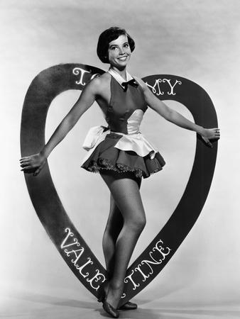 https://imgc.allpostersimages.com/img/posters/leslie-caron-mgm-valentine-s-day-pin-up-early-1950s_u-L-PTAKMB0.jpg?p=0