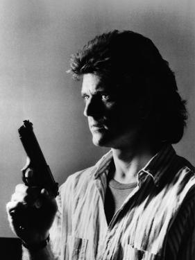 LETHAL WEAPON, 1987 directed by RICHARD DONNER Mel Gibson (b/w photo)