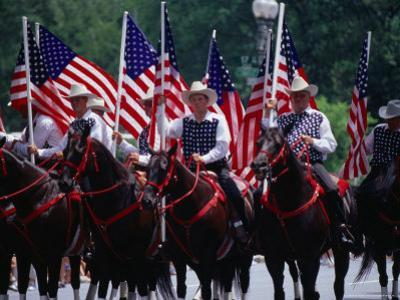 Equestrian Riders in 4th of July Parade on Constitution Avenue, Washington DC, USA