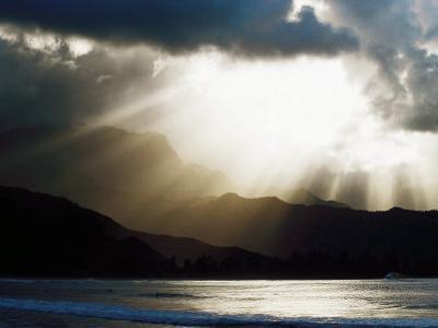 Sun Shining Through Clouds with Mountain Backdrop, Hanalei Beach, Po-Ipu, U.S.A.