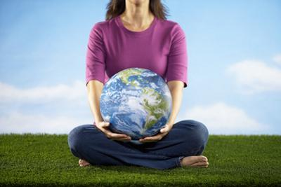 Woman Holding Earth in Her Lap